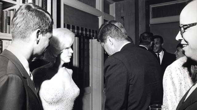 Monroe with the two Kennedy brothers. Awwwkwaard...  (Source: Wikipedia)